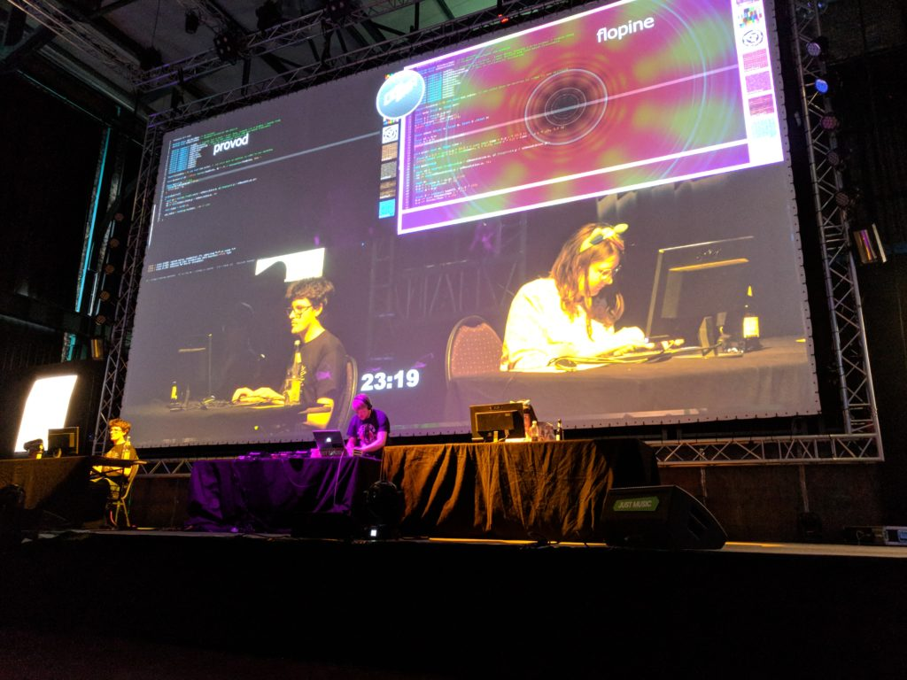 Photo of the Revision 2018 final match: provod vs Flopine, with Ronny mixing.